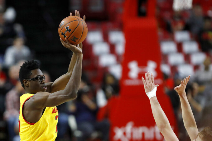 Maryland forward Jalen Smith shoots a basket as Nebraska guard Thorir Thorbjarnarson defends during the first half of an NCAA college basketball game, Tuesday, Feb. 11, 2020, in College Park, Md. (AP Photo/Julio Cortez)