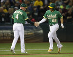 Oakland Athletics' Matt Chapman, right, celebrates with third base coach Matt Williams (4) after hitting a two-run home run off Seattle Mariners' Marco Gonzales during the fifth inning of a baseball game Tuesday, July 16, 2019, in Oakland, Calif. (AP Photo/Ben Margot)