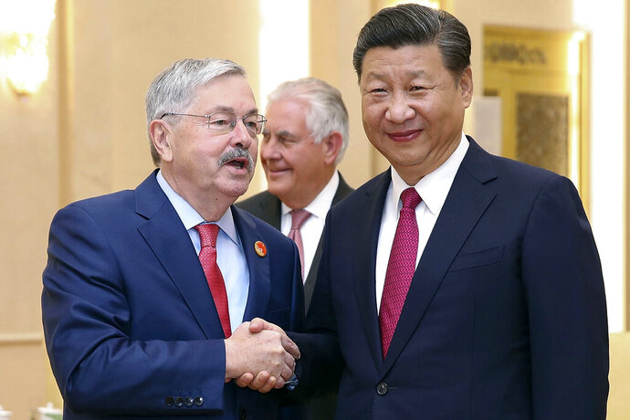 FILE - In this Sept. 30, 2017, file photo, U.S. Ambassador Terry Edward Branstad, left, shakes hands with China's President Xi Jinping at the Great Hall of the People in Beijing. The U.S. ambassador to China is making a rare visit to Tibet to meet local officials and raise concerns about restrictions on Buddhist practices and the preservation of the Himalayan region's unique culture and language. (Lintao Zhang/Pool Photo via AP, File)