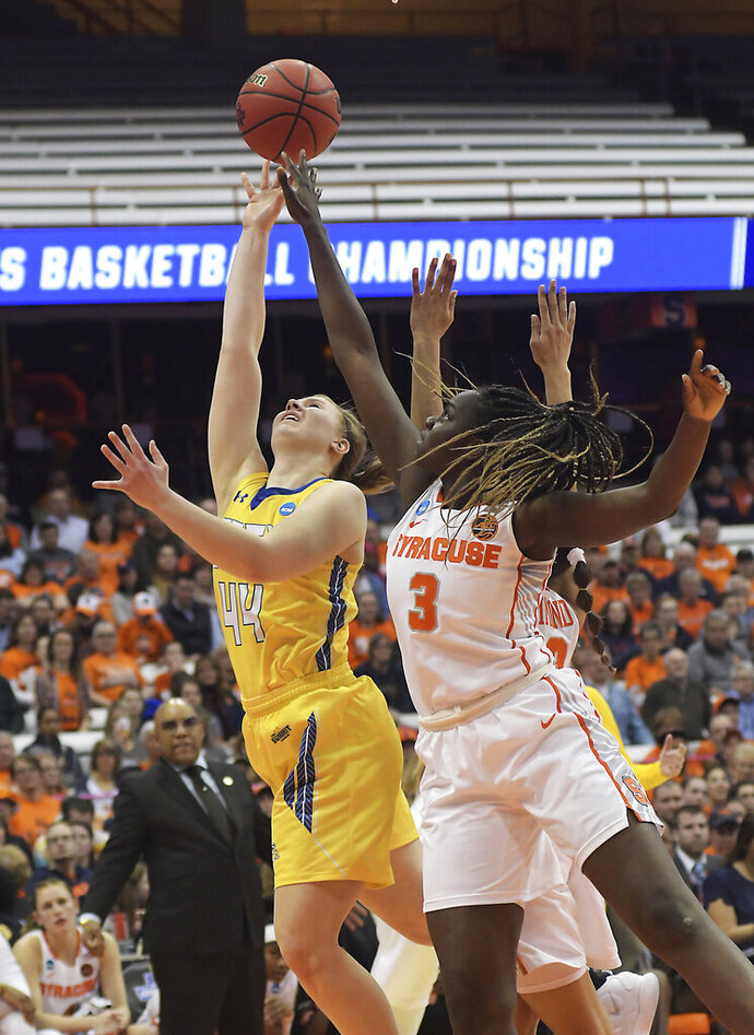 South Dakota State's Myah Selling (44) shoots as Syracuse's Maeva Djaldi-Tabdi (3) defends during a-second round game in the NCAA women's college basketball tournament in Syracuse, N.Y., Monday, March 25, 2019. (AP Photo/Heather Ainsworth)