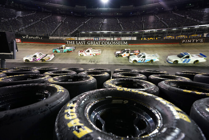 The field passes through Turn 2 during the NASCAR Truck Series auto race Thursday, Sept. 17, 2020, in Bristol, Tenn. (AP Photo/Steve Helber)