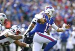 Buffalo Bills quarterback Josh Allen tries to break free from the grasp of of New England Patriots defensive tackle Lawrence Guy in the first half of an NFL football game, Sunday, Sept. 29, 2019, in Orchard Park, N.Y. (AP Photo/Ron Schwane)