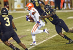 Clemson running back Travis Etienne gets past Wake Forest 's Ja'Cquez William (8) in the first half of an NCAA college football game Saturday, Sept. 12, 2020, in Winston-Salem, N.C. (Walt Unks/The Winston-Salem Journal via AP)
