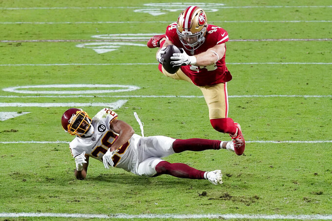 San Francisco 49ers fullback Kyle Juszczyk (44) dives into the end zone for a touchdown as San Francisco 49ers strong safety Jaquiski Tartt (29) defends during the second half of an NFL football game, Sunday, Dec. 13, 2020, in Glendale, Ariz. (AP Photo/Ross D. Franklin)