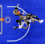 Marquette forward Brendan Bailey, top left, and teammate forward Ed Morrow, top right, go up for a defensive rebound against Seton Hall guard Myles Cale, left, and guard Jared Rhoden during the second half of an NCAA college basketball game, Wednesday, March 6, 2019, in Newark, N.J. Seton Hall won 73-64. (AP Photo/Julio Cortez)