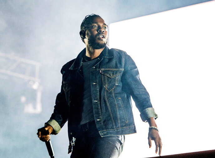 FILE - In this July 7, 2017, file photo, Kendrick Lamar performs during the Festival d'ete de Quebec in Quebec City, Canada. Lamar was nominated for a Golden Globe for best original song for