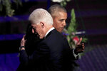 Former presidents Barack Obama, left, and Bill Clinton hug at the end of funeral services for Rep. Elijah Cummings, Friday, Oct. 25, 2019, in Baltimore. The Maryland congressman and civil rights champion died Thursday, Oct. 17, at age 68 of complications from long-standing health issues. (AP Photo/Julio Cortez, Pool)