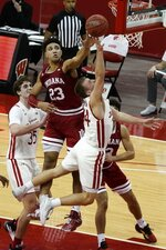 Indiana's Trayce Jackson-Davis block the shot of Wisconsin's Brad Davison during overtime of an NCAA college basketball game Thursday, Jan. 7, 2021, in Madison, Wis. (AP Photo/Morry Gash)