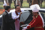 Sri Lankan Prime Minister Mahinda Rajapaksa arrives at the Indian presidential palace for his ceremonial reception in New Delhi, India, Saturday, Feb. 8, 2020. (AP Photo/Manish Swarup)