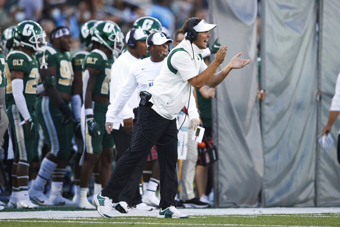 Charlotte coach Will Healy applauds from the sideline during the team's NCAA college football game against Duke on Friday, Sept. 3, 2021, in Charlotte, N.C. (AP Photo/Brian Westerholt)