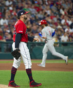 Cleveland Indians relief pitcher Oliver Perez walks off the mound as Philadelphia Phillies' Bryce Harper rounds the bases after hitting a three-run home run during the fifth inning of a baseball game in Cleveland, Saturday, Sept. 21, 2019. (AP Photo/Phil Long)