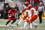 Maryland wide receiver Jeshaun Jones, left, rushes the ball against a group of Illinois defenders in the first half of an NCAA college football game, Saturday, Oct. 27, 2018, in College Park, Md. (AP Photo/Patrick Semansky)