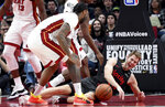 Portland Trail Blazers forward Jake Layman, right, scrambles with Miami Heat forward James Johnson, left, on the court for a loose ball during the first half of an NBA basketball game in Portland, Ore., Tuesday, Feb. 5, 2019. (AP Photo/Steve Dykes)