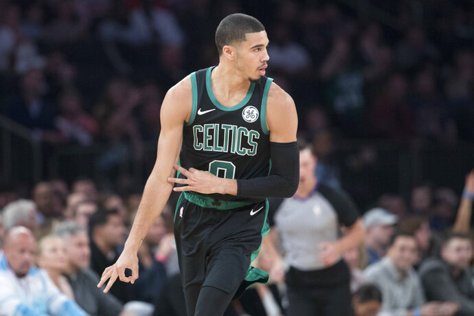 Boston Celtics forward Jayson Tatum gestures after scoring a three-point goal during the first half of an NBA basketball game against the New York Knicks, Saturday, Oct. 20, 2018, at Madison Square Garden in New York. (AP Photo/Mary Altaffer)
