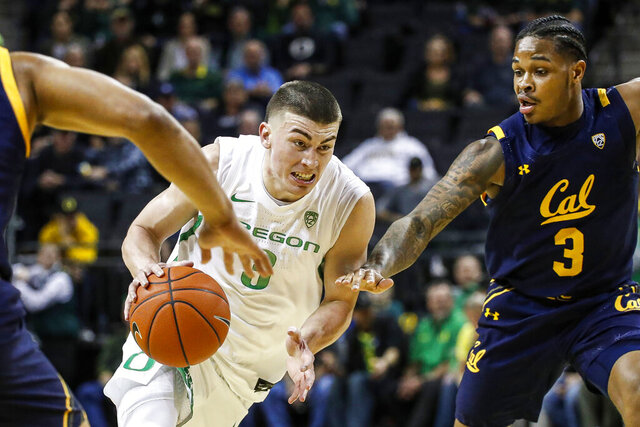 Oregon guard Payton Pritchard (3) drives to the basket against California guard Paris Austin (3) during the first half of an NCAA college basketball game in Eugene, Ore., Thursday, March 5, 2020. (AP Photo/Thomas Boyd)
