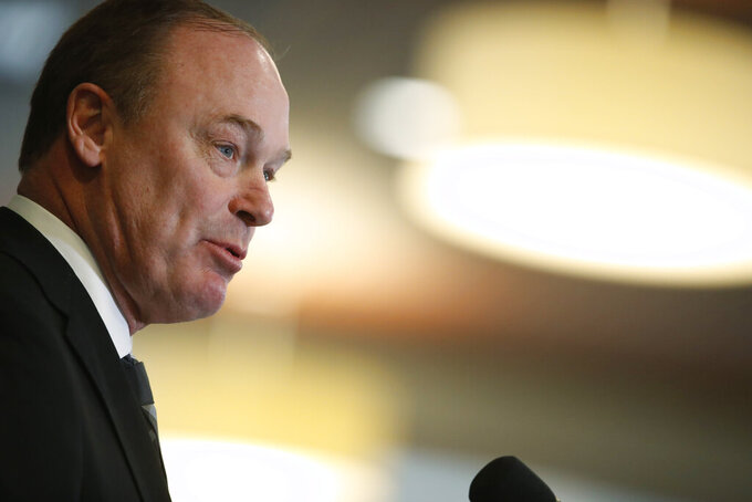 Colorado athletic director Rick George announces that Karl Dorrell is the new NCAA college head football coach at Colorado during a news conference Monday, Feb. 24, 2020, in Boulder, Colo. (AP Photo/David Zalubowski)
