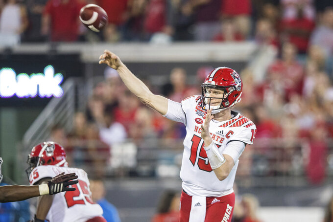 North Carolina State quarterback Ryan Finley (15) throws a pass against Texas A&M during the first half of the Gator Bowl NCAA college football game Monday, Dec. 31, 2018, in Jacksonville, Fla. (James Gilbert/The Florida Times-Union via AP)