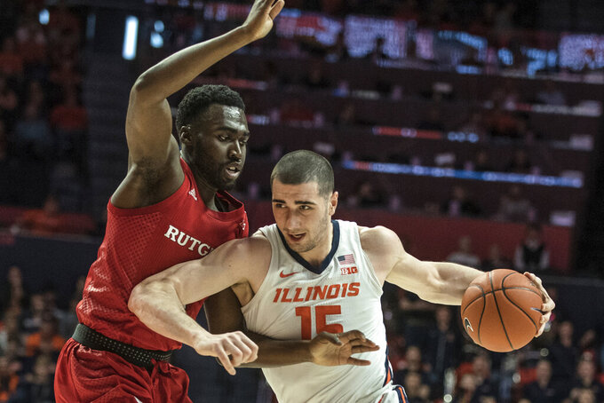 Illinois' Giorgi Bezhanishvili (15) tries to power past Rutgers' Shaq Carter (13) in the first half of an NCAA college basketball game, Sunday, Jan. 11, 2020, in Champaign, Ill. (AP Photo/Holly Hart)