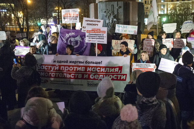 In this photo taken on Monday, Nov. 25, 2019, people hold banners against domestic violence as they attend a rally in Moscow's downtown, Russia. The rally in support of a widely anticipated domestic violence bill gathered several hundred people. Women's rights activists have organized a whole series of rallies in recent weeks, urging the authorities to take action in tackling domestic violence, rampant in Russia, where 40% of all violent crimes occur in families. (AP Photo/Pavel Golovkin)