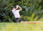 Justin Thomas of the United States follows his shot on the fifth hole during round two of the CIMB Classic golf tournament at Tournament Players Club (TPC) in Kuala Lumpur, Malaysia, Friday, Oct. 12, 2018. (AP Photo/Yam G-Jun)