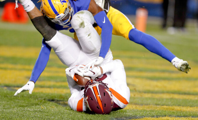 Virginia Tech wide receiver Eric Kumah (83) makes a catch for a touchdown as Pittsburgh defensive back Jason Pinnock (15) defends in the third quarter of an NCAA football game, Saturday, Nov. 10, 2018, in Pittsburgh. Pittsburgh won 52-22.(AP Photo/Keith Srakocic)