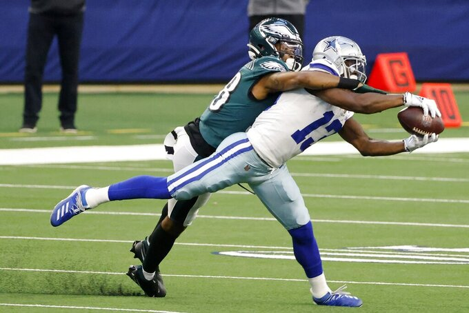 Dallas Cowboys wide receiver Michael Gallup (13) catches a pass as Philadelphia Eagles cornerback Michael Jacquet (38) defends in the first half of an NFL football game in Arlington, Texas, Sunday, Dec. 27. 2020. (AP Photo/Michael Ainsworth)