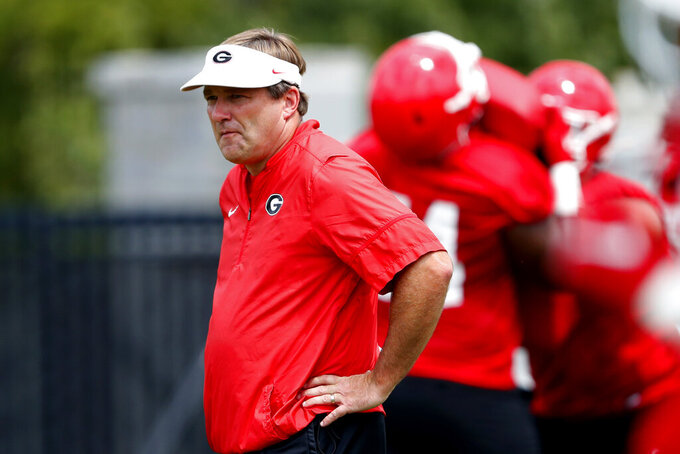 Georgia head coach Kirby Smart watches drills during the team's first scheduled NCAA college football practice Friday, Aug. 2, 2019, in Athens, Ga. (AP Photo/John Bazemore)