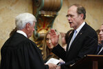 Lt. Gov. Delbert Hosemann, right, is sworn into office by Mississippi Supreme Court Chief Justice Michael Randolph in House chambers at the Mississippi Capitol in Jackson, Miss., Thursday, Jan. 9, 2020. (AP Photo/Rogelio V. Solis)