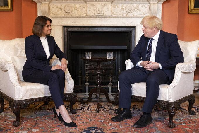 Belarus opposition leader Sviatlana Tsikhanouskaya meets with the British Prime Minister Boris Johnson, right, in 10 Downing Street, London, Tuesday, Aug. 3, 2021. (Dan Kitwood/Pool via AP)