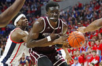 Mississippi guard Terence Davis (3) knocks the ball away from Mississippi State forward Abdul Ado (24) during the second half of an NCAA college basketball game in Oxford, Miss., Saturday, Feb. 2, 2019. Mississippi State won 81-75. (AP Photo/Rogelio V. Solis)