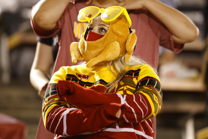 Iowa State student Hannah Johnson dances while wearing a turkey head covering during a timeout during the second half of an NCAA college football game between Iowa State and Baylor on Saturday, Nov. 7, 2020, in Ames, Iowa. Iowa State won 38-31. (AP Photo/Matthew Putney)