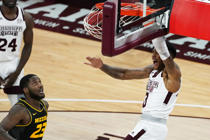 Mississippi State guard D.J. Stewart Jr. (3) shouts as he dunks next to Missouri forward Jeremiah Tilmon (23) during the first half of an NCAA college basketball game Tuesday, Jan. 5, 2021, in Starkville, Miss. (AP Photo/Rogelio V. Solis)