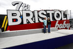 "Lisa Odle and Elijah Duke of Nashville, Tenn. have their photo taken in front of the ""It's BRISTOL baby"" sign after races for both the Truck Series and NASCAR Cup Series auto race was postponed due to inclement weather at Bristol Motor Speedway, Sunday, March 28, 2021, in Bristol, Tenn. (AP Photo/Wade Payne)"