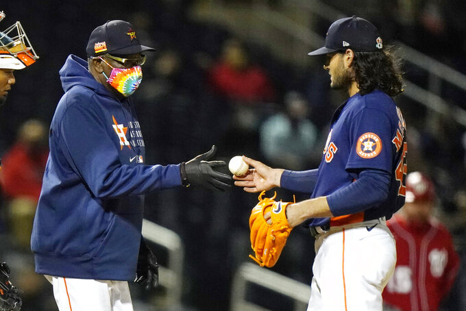 Houston Astros manager Dusty Baker Jr. takes the ball from starting pitcher Lance McCullers Jr. as he is relieved during the third inning of a spring training baseball game against the Washington Nationals, Tuesday, March 9, 2021, in West Palm Beach, Fla. (AP Photo/Lynne Sladky)