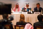 OPEC Secretary-General Mohammed Barkindo, left, Saudi Energy Minister Prince Abdulaziz bin Salman, center, and Russian Energy Minister Alexander Novak, attend a news conference after an OPEC meeting in Abu Dhabi, United Arab Emirates, Thursday, Sept. 12, 2019. OPEC's Joint Ministerial Monitoring Committee met Thursday in Abu Dhabi as estimates of lowered crude oil demand in 2020 have the cartel considering additional production cuts. Before the meeting started, Prince Abdulaziz again called for