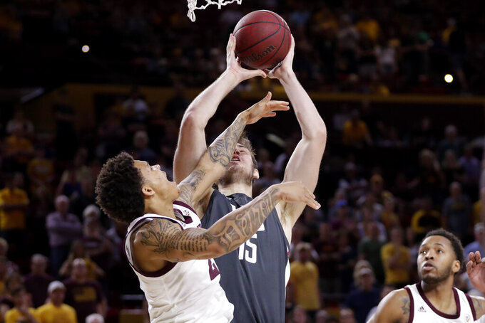 Washington State center Volodymyr Markovetskyy (15) is hit by Arizona State guard Rob Edwards as he scores a basket during the first half of an NCAA college basketball game Saturday, March 7, 2020, in Tempe, Ariz. (AP Photo/Matt York)