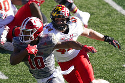 Indiana running back David Ellis (10) runs past Maryland's Chance Campbell (44) during the first half of an NCAA college football game, Saturday, Nov. 28, 2020, in Bloomington, Ind. (AP Photo/Darron Cummings)