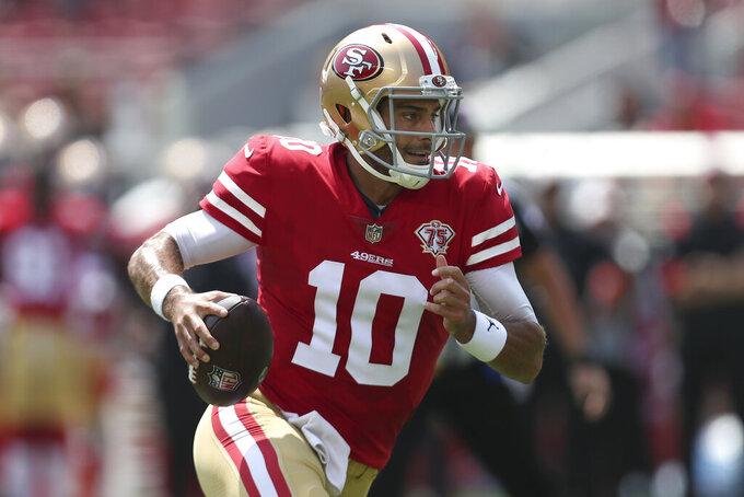San Francisco 49ers quarterback Jimmy Garoppolo runs for a touchdown against the Las Vegas Raiders during the first half of an NFL preseason football game in Santa Clara, Calif., Sunday, Aug. 29, 2021. (AP Photo/Jed Jacobsohn)