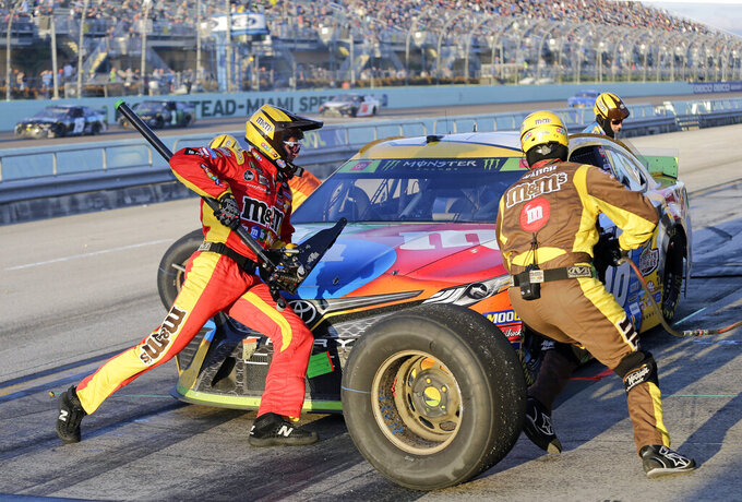 Kyle Busch makes a pit stop during a NASCAR Cup Series auto race on Sunday, Nov. 17, 2019, at Homestead-Miami Speedway in Homestead, Fla. Busch won the race and the season championship. (AP Photo/Terry Renna)