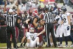 Akron kicker Nick Gasser (48) reacts to a South Carolina touchdown after he fumbled the ball during the first half of an NCAA college football game Saturday, Dec. 1, 2018, in Columbia, S.C. (AP Photo/Sean Rayford)