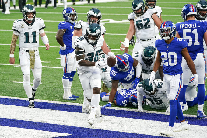 Philadelphia Eagles' Corey Clement (30) celebrates after scoring a touchdown during the second half of an NFL football game against the New York Giants, Sunday, Nov. 15, 2020, in East Rutherford, N.J. (AP Photo/Seth Wenig)