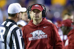 Arkansas coach Barry Lunney, Jr. talks to an official during the first half of the team's NCAA college football game against LSU in Baton Rouge, La., Saturday, Nov. 23, 2019. (AP Photo/Matthew Hinton)