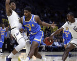 California's Juhwan Harris-Dyson, right, strips the ball from UCLA's Cody Riley, center, during the first half of an NCAA college basketball game Wednesday, Feb. 13, 2019, in Berkeley, Calif. At left is California's Andre Kelly. (AP Photo/Ben Margot)