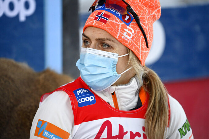 Therese Johaug of Norway wears a protective face mask after finishing the women's cross country skiing classic style 10-kilometer competition at the FIS World Cup Ruka Nordic event in Kuusamo, Finland, Saturday, Nov. 28, 2020. (Emmi Korhonen/Lehtikuva via AP)