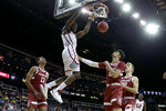 Oklahoma forward Victor Iwuakor (0) dunks the ball during the first half of an NCAA college basketball game against Stanford Monday, Nov. 25, 2019, in Kansas City, Mo. (AP Photo/Charlie Riedel)