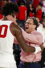 Georgia coach Tom Crean celebrates with Rayshaun Hammonds after the team's NCAA college basketball against Arkansas in Athens, Ga., Saturday, Feb. 29, 2020. Georgia won 99-89. (Joshua L. Jones/Athens Banner-Herald via AP)