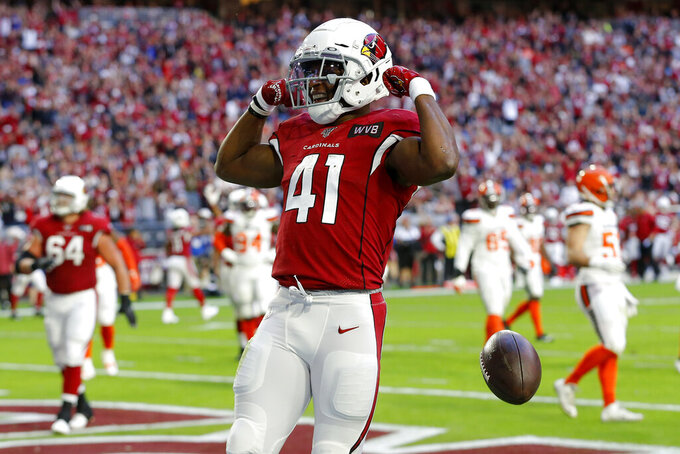 Arizona Cardinals running back Kenyan Drake (41) celebrates his touchdown against the Cleveland Browns during the first half of an NFL football game, Sunday, Dec. 15, 2019, in Glendale, Ariz. (AP Photo/Rick Scuteri)