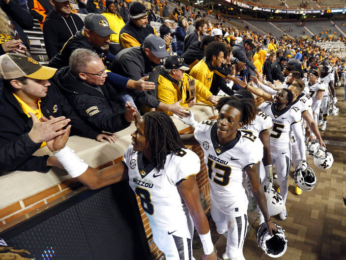 Missouri players celebrate with fans after defeating Tennessee 50-17 in an NCAA college football game Saturday, Nov. 17, 2018, in Knoxville, Tenn. (AP Photo/Wade Payne)