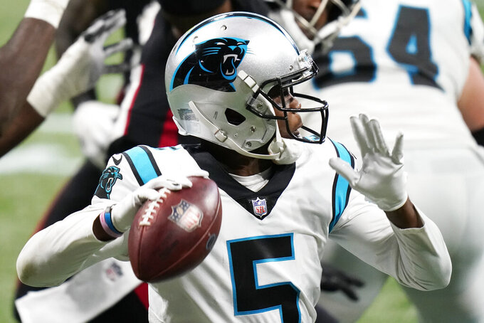 Carolina Panthers quarterback Teddy Bridgewater (5) works against the Atlanta Falcons during the first half of an NFL football game, Sunday, Oct. 11, 2020, in Atlanta. (AP Photo/Brynn Anderson)