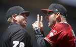 Arizona Diamondbacks manager Torey Lovullo, right, gestures to home plate umpire Mike Muchlinski after his ejection in the fifth inning of a baseball game against the San Francisco Giants, Sunday, June 30, 2019, in San Francisco. (AP Photo/Ben Margot)